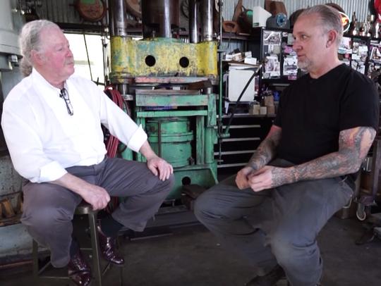 Albert Paley, left, and Jesse James discuss plans fir their joint sculptures.