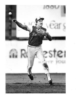 Former Rochester Red Wings infielder Wayne Krenchicki makes a throw to first base at Silver Stadium.