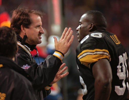 Pittsburgh Steelers coach Bill Cowher, left, has a heated discussion with lineman Greg Lloyd during the Steeler's 20-17 win over the Cleveland Browns on Nov. 26, 1995, in Cleveland. Cowher was the featured speaker at the Ben R. Giambrone Compeer Sports Luncheon on Thursday.