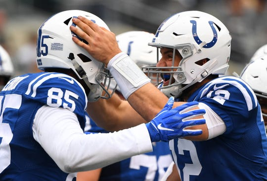 Indianapolis Colts tight end Eric Ebron (85) celebrates a touchdown with quarterback Andrew Luck (12) in the third quarter against the New York Jets.
