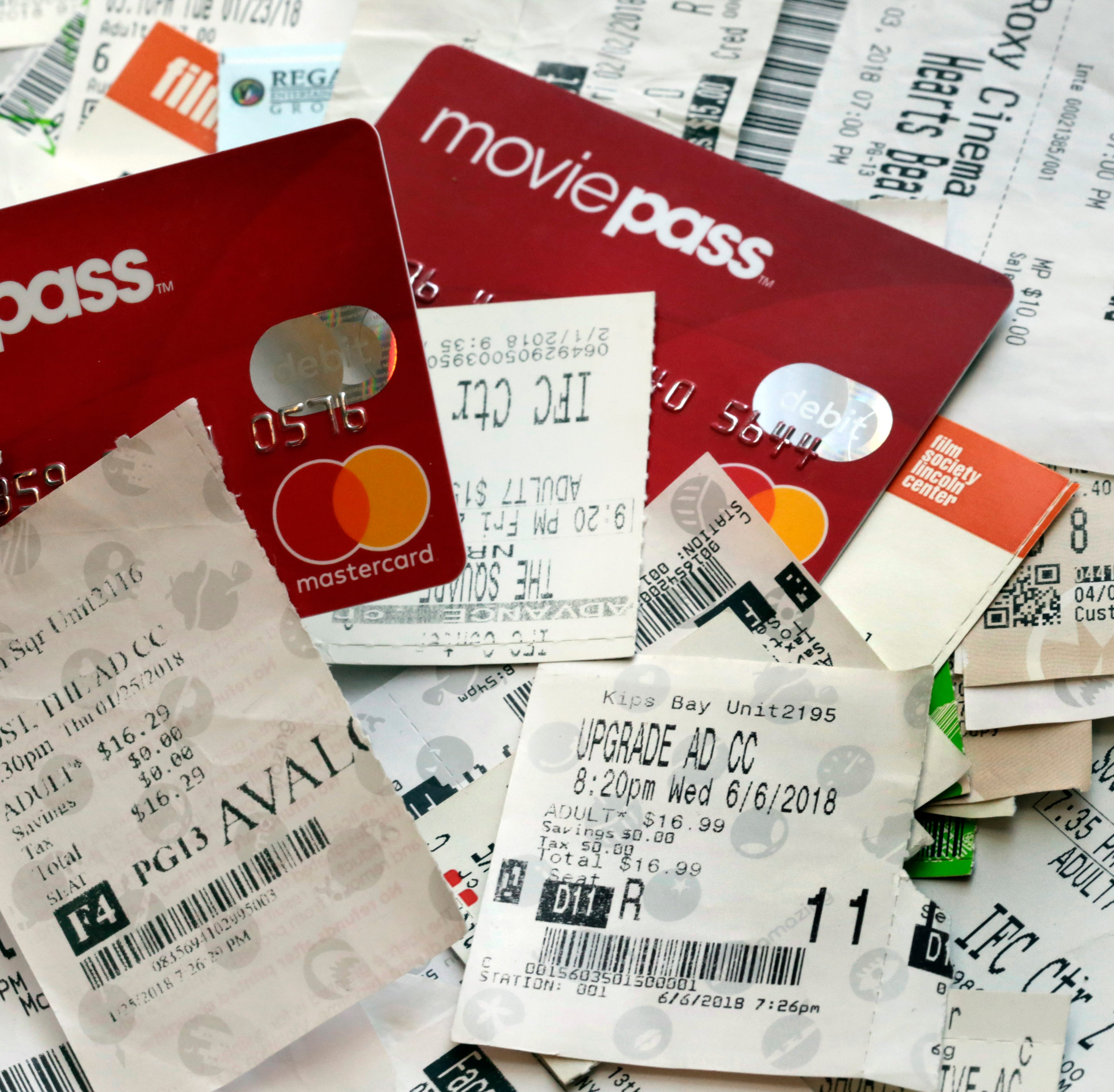 This Aug. 23, 2018, file photo shows Movie Pass debit cards and used movie tickets in New York. The company that runs the beleaguered MoviePass, a discount service for movie tickets at theaters, is being investigated by the New York Attorney General on allegations it misled investors.