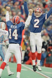 Buffalo Bills kicker Steve Christie, right, celebrates his game-winning field goal with quarterback Frank Reich as the Bills beat the Houston Oilers in overtime 41-38 on Jan. 3, 1993 in Orchard Park.