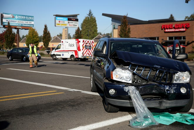 Emergency personnel respond to a two-vehicle crash at Commercial St. SE and Vista Ave. SE in Salem on Thursday, Oct. 18, 2018. Three people were transported to Salem Health with non life-threatening injuries.
