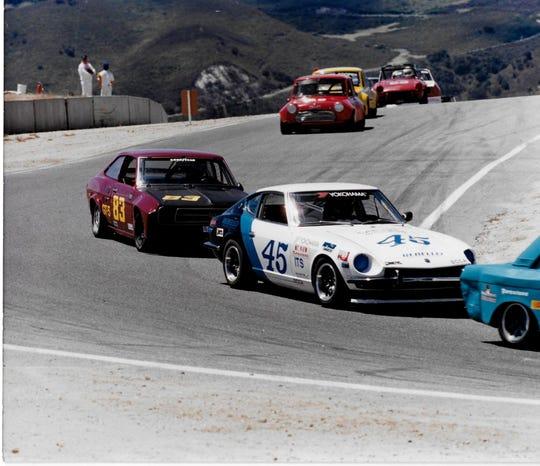 Richard Reins (No. 83) races at Laguna Seca.