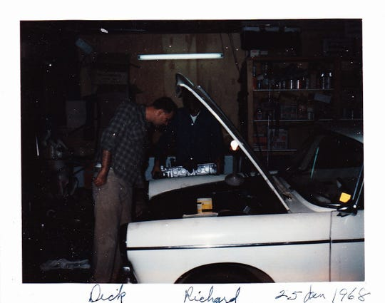 Richard Reins working on a car engine with his father, Dick Reins, who taught him how to tinker with a car, in 1968.