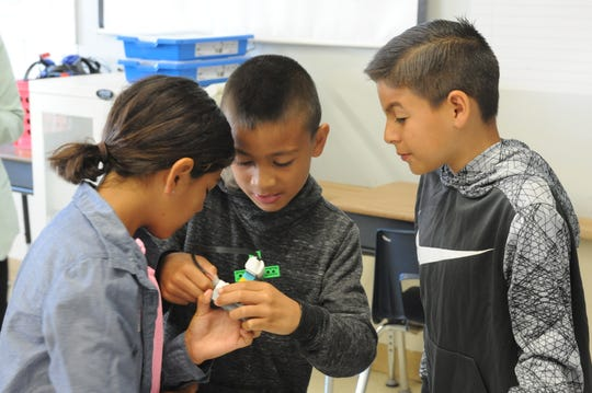 Students from Lesley Kong's fourth grade class work together on their new LEGO STEM kits on Wednesday.