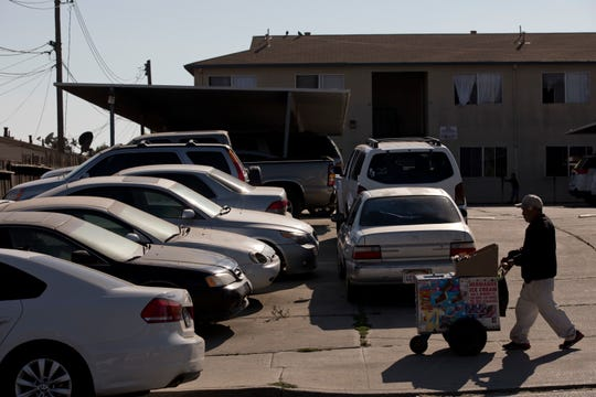 In this Thursday, Sept. 6, 2018, photo, cars are double-parked in the parking lot of an apartment complex in Salinas, Calif. Salinas is an affordable location compared to Silicon Valley, where median home prices are about $1 million, but with a less-wealthy population and a median home price that has ballooned to about $550,000, it's one of the least affordable places in America. (AP Photo/Jae C. Hong)