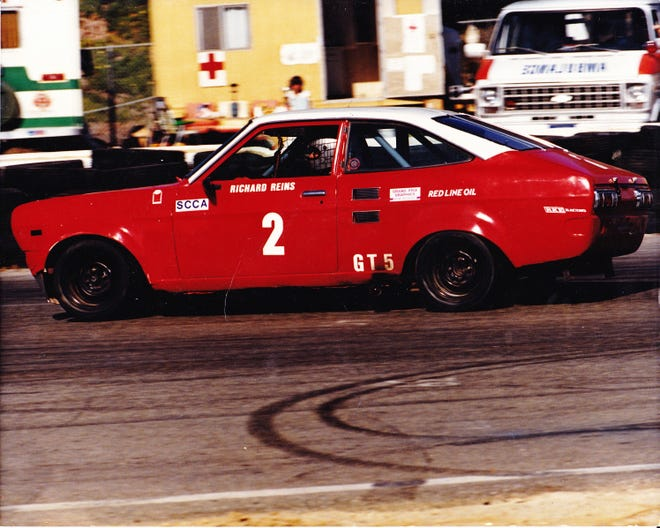 A young Richard Reins in his racecar.