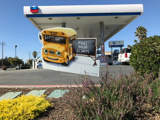 Signs for Chevron's Fuel Your School initiative at its gas station on Abbott Street and Blanco Road in Salinas