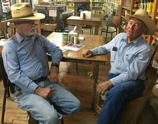 James Low (left) and Roddy Maddox talk about their football coaching days at Miss Sue's Sweet Tea in downtown Cherokee.