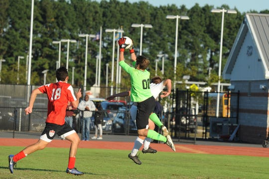 JMB goalie Gabe Dunn goes up for a save against Decatur in Bayside South soccer action Oct. 17, 2018.
