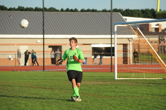 Former JMB goalie Gabe Dunn goes for a save against Stephen Decatur in Bayside South soccer action Oct. 17, 2018.
