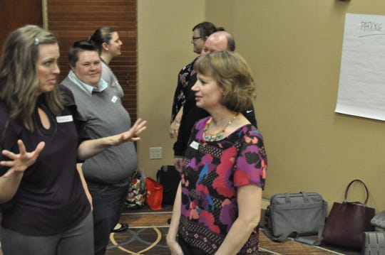 Safe Bars training attendees role-play possible sexual assault intervention scenarios during Safe Bars training Thursday, Oct. 18, 2018.