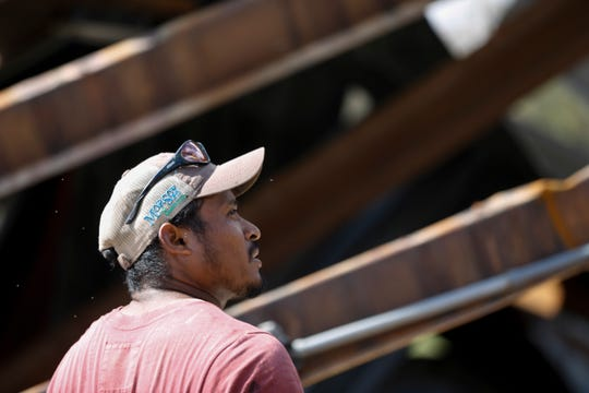 Inocencio Sanchez, a Progressive Pecans employee, takes a look around Seldom Rest Farm in Donalsonville, Ga. and the damage done by Hurricane Michael Wednesday, Oct. 17, 2018.