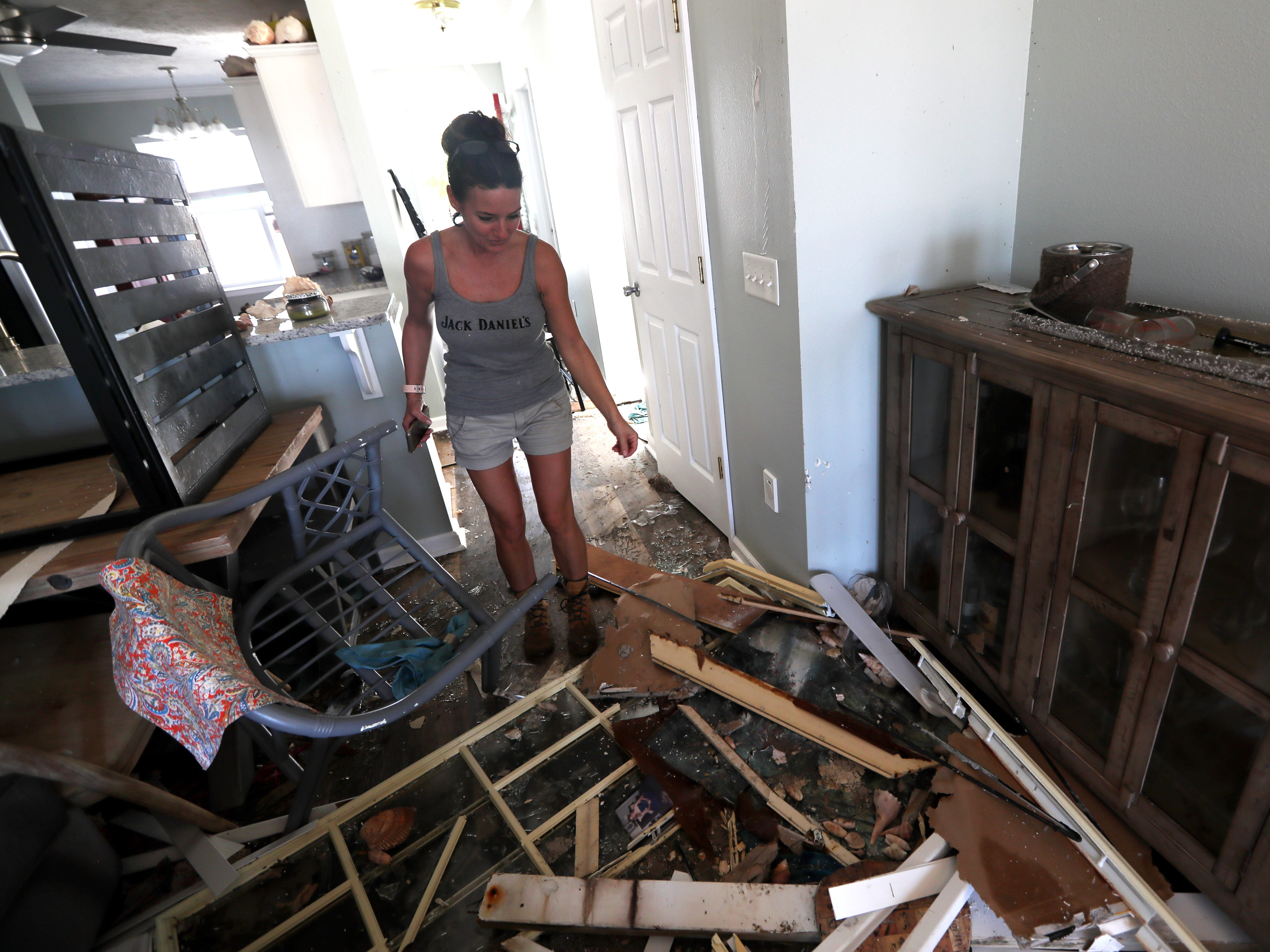 Kimberly Higdon looks over the broken debris that is left of her living room at her Mexico Beach condo on Wednesday, Oct. 17, 2018, one week after Hurricane Michael ripped through the coastal Florida town.