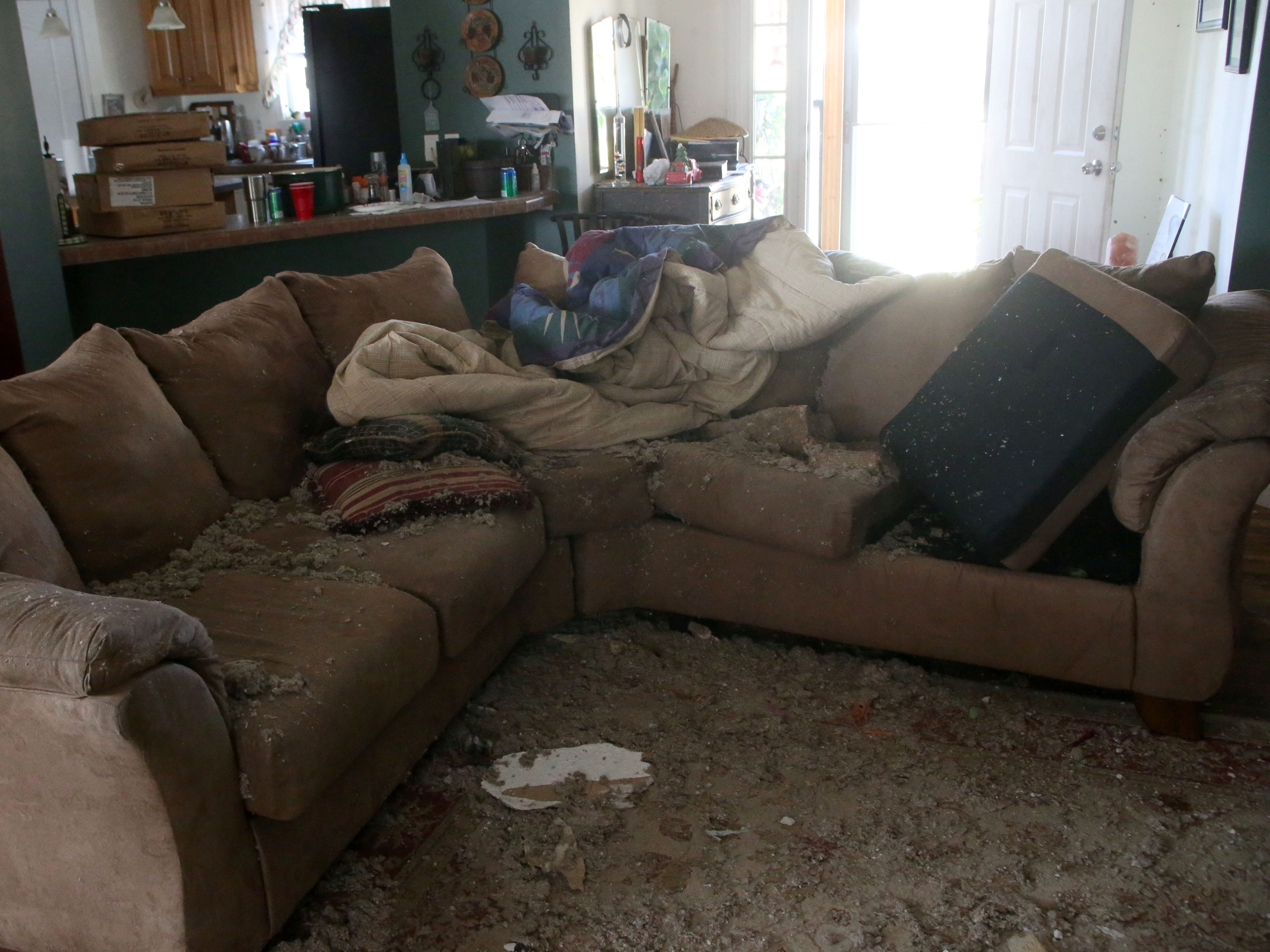 Remnants of the concrete that killed Sarah Radney, an 11 year old girl who died during Hurricane Michael in Donalsonville, Ga., remain on the couch in her grandparents' home,  on Thursday, Oct. 18, 2018.