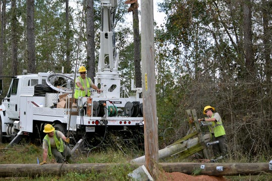 JoAnna Booty (right), a 23-year-old from Kentwood, Louisiana, works with her co-op as an apprentice linemen to make repairs to a downed pole in Havana.