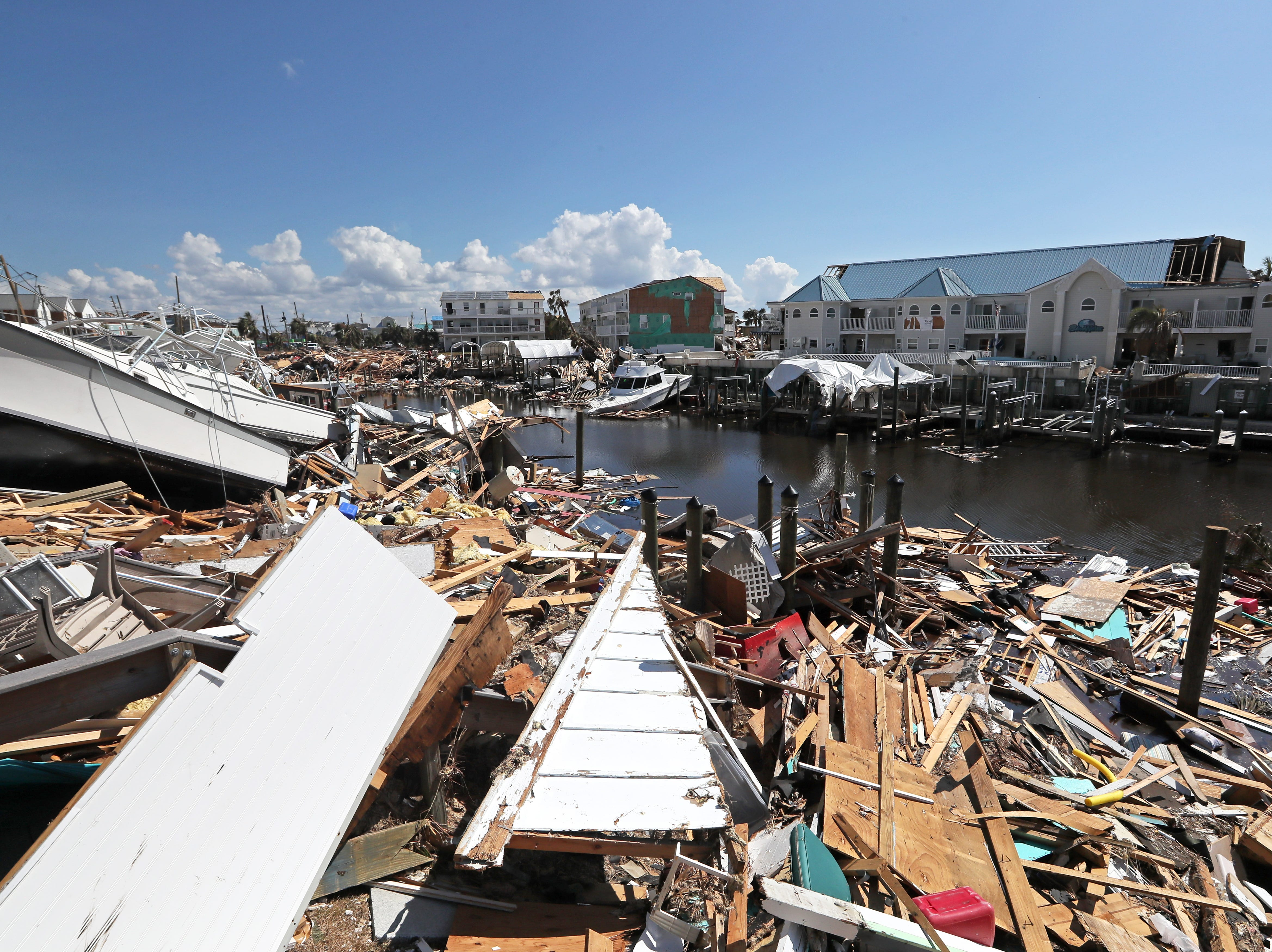 Broken boats and homes litter the waterways in Mexico Beach on Wednesday, Oct. 17, 2018, one week after Hurricane Michael ripped through the coastal Florida town.
