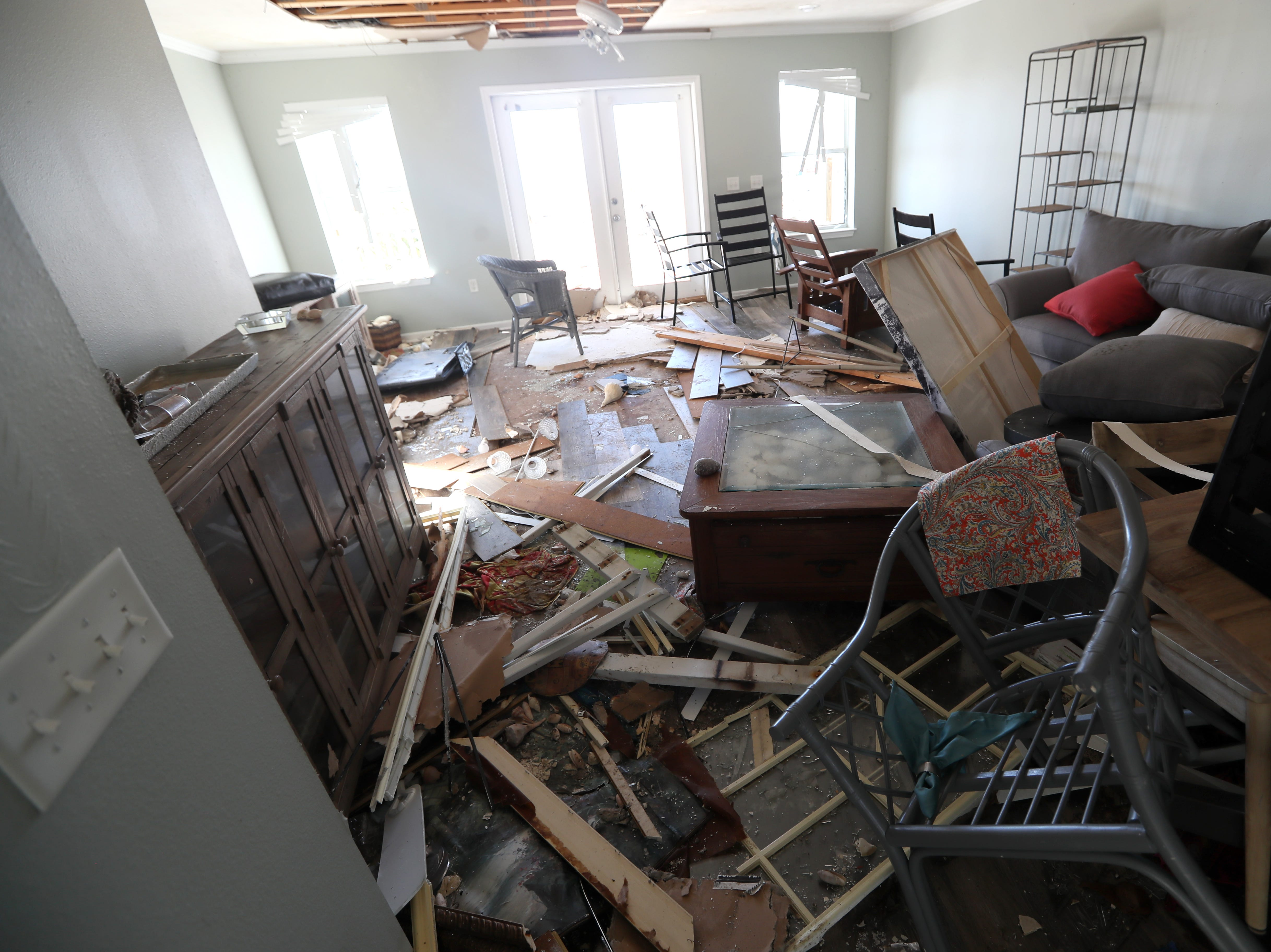 The Higdon family Mexico Beach condo is scattered with furniture and debris on Wednesday, Oct. 17, 2018, one week after Hurricane Michael ripped through the coastal Florida town.