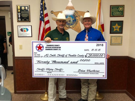 Sheriff Brian Hawthorne of Chambers County, Texas, delivered a check and supplies to Franklin County Sheriff AJ Smith on on Mondayl