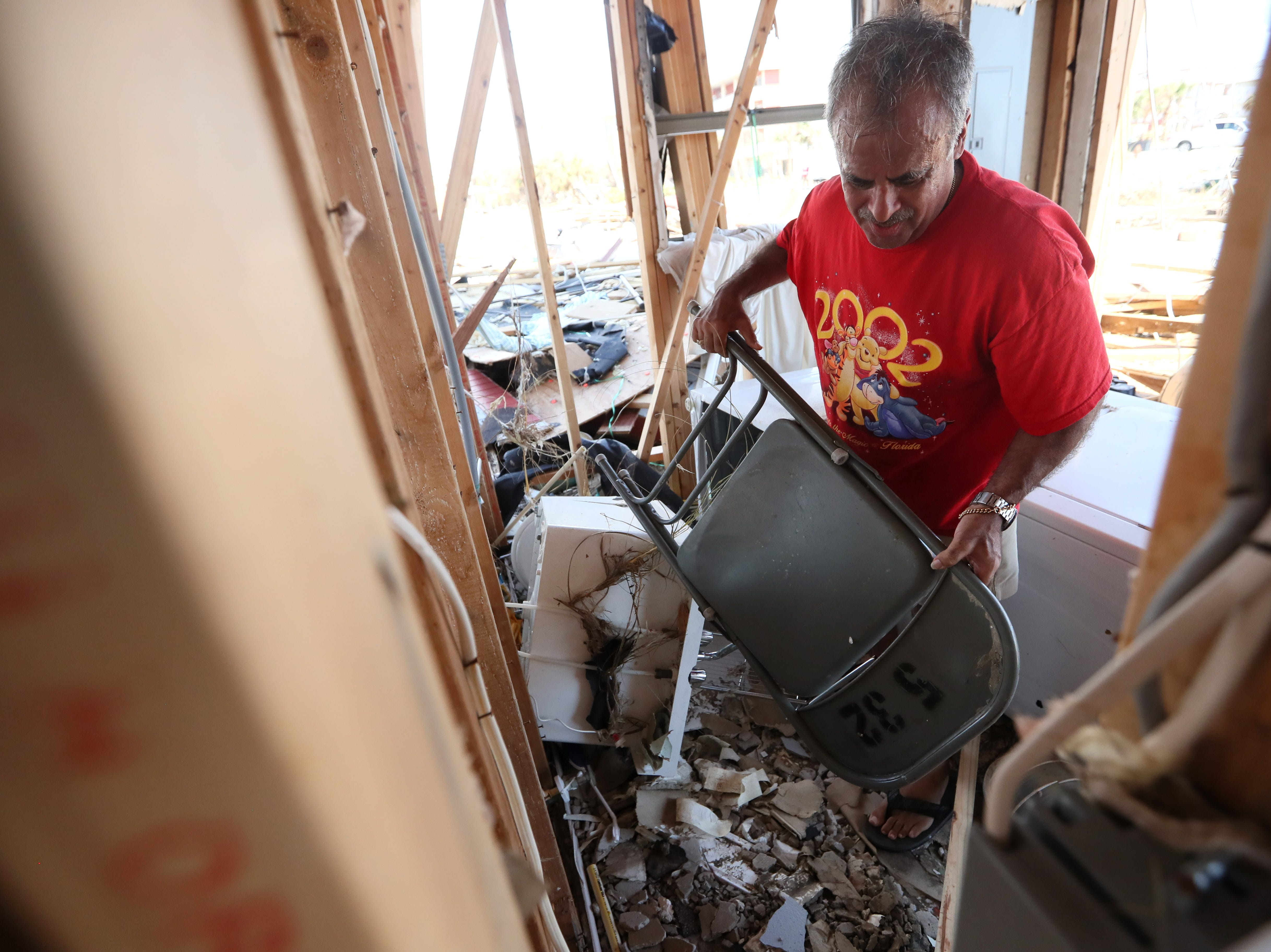 Jaques Sebastiao stands inside of his demolished Mexico Beach home on Wednesday, Oct. 17, 2018, one week after Hurricane Michael ripped through the coastal Florida town. Sebastiao moved in to the home fulltime with his with wife Bela just two months ago.