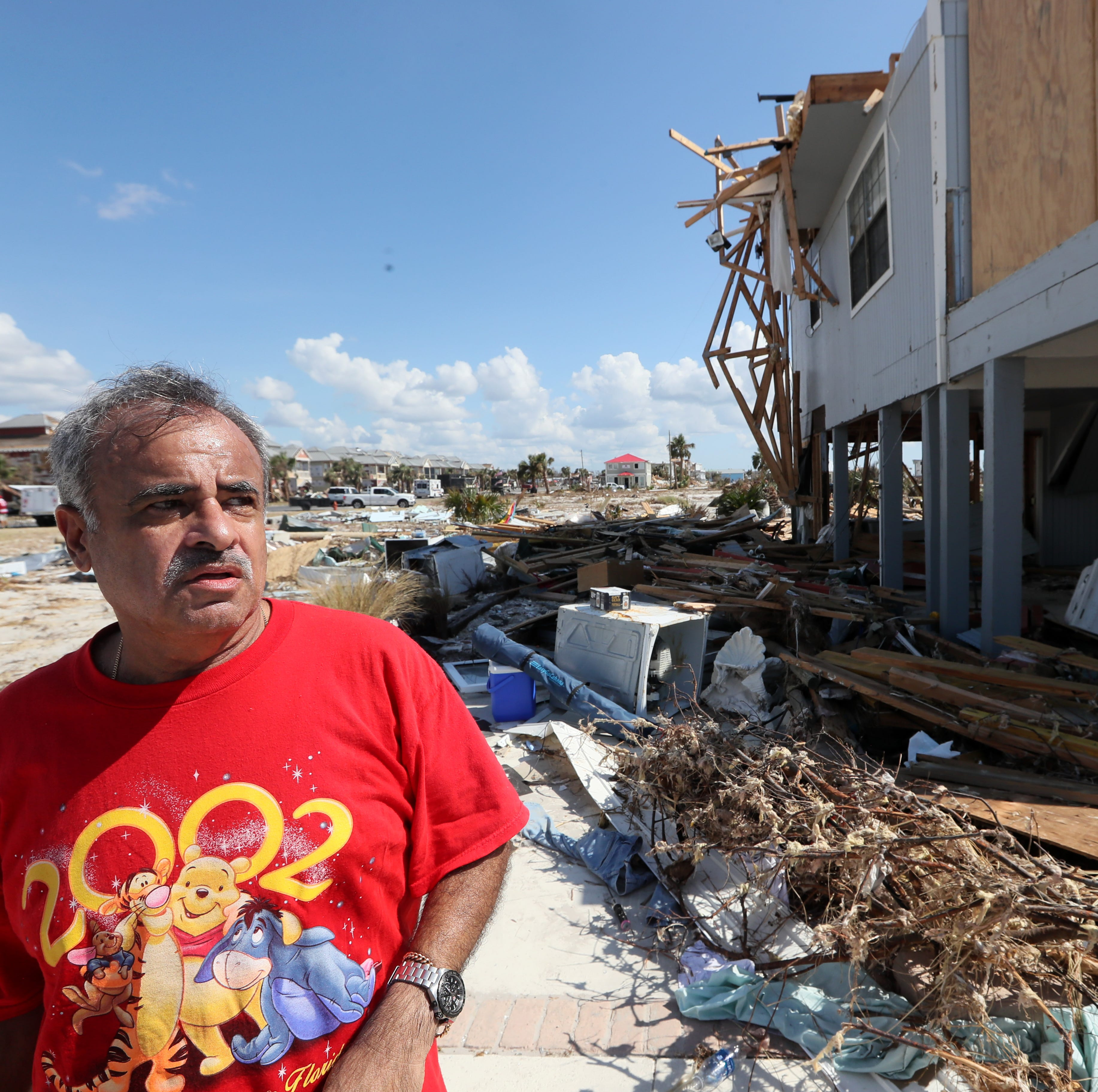 Jaques Sebastiao stands outside of his demolished Mexico Beach home on Wednesday, Oct. 17, 2018, one week after Hurricane Michael ripped through the coastal Florida town. Sebastiao moved in to the home fulltime with his with wife Bela two months ago.