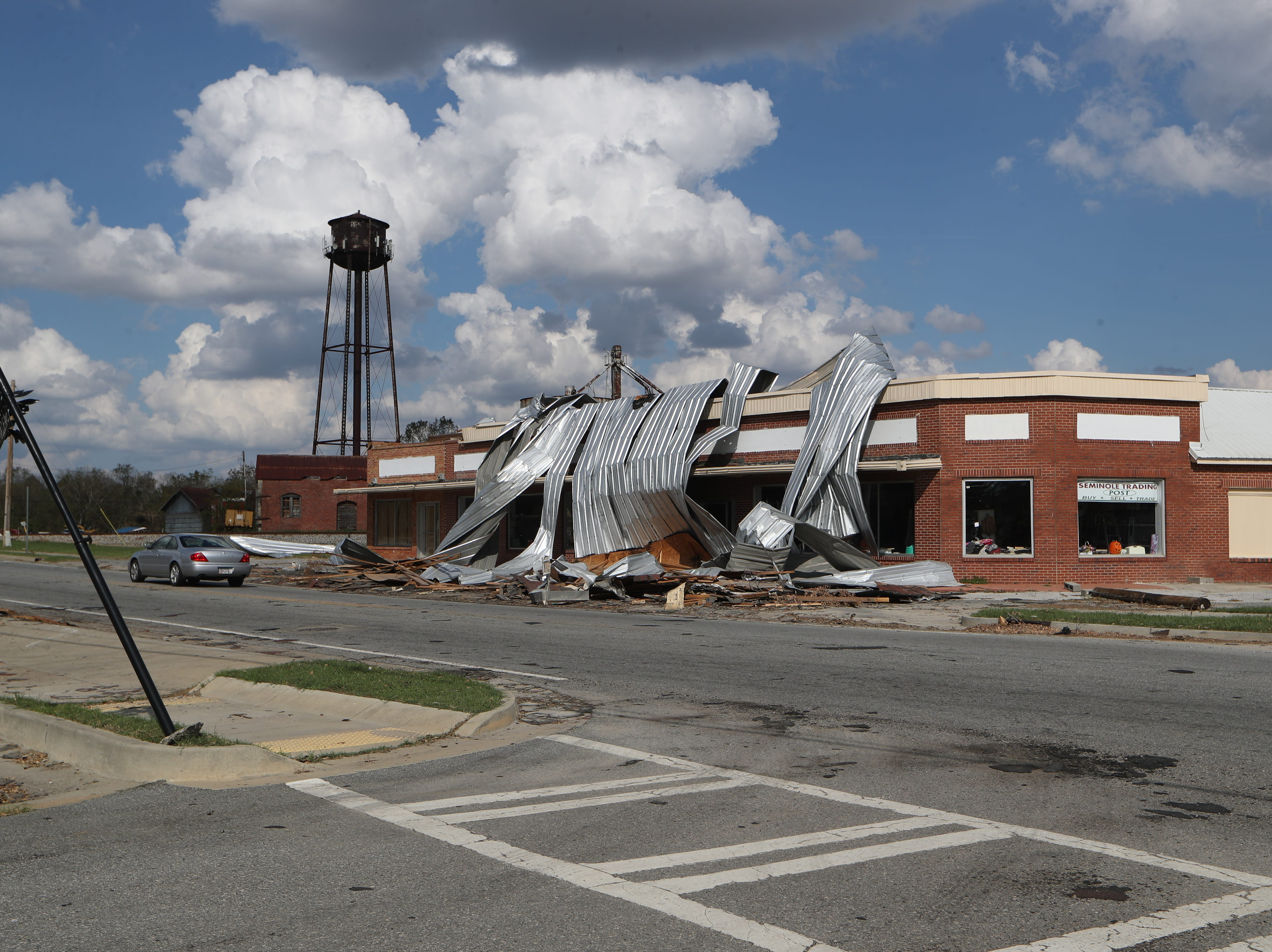 A roof is peeled off a building near downtown Donalsonville, Ga. after Hurricane Michael Wednesday, Oct. 17, 2018.