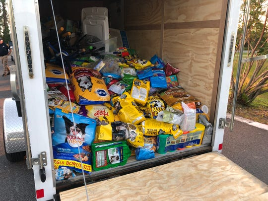 Deliver cleaning supplies, shovels, tools, pet food  and a $20,000 check to Franklin County's officer charity fund on Wednesday.