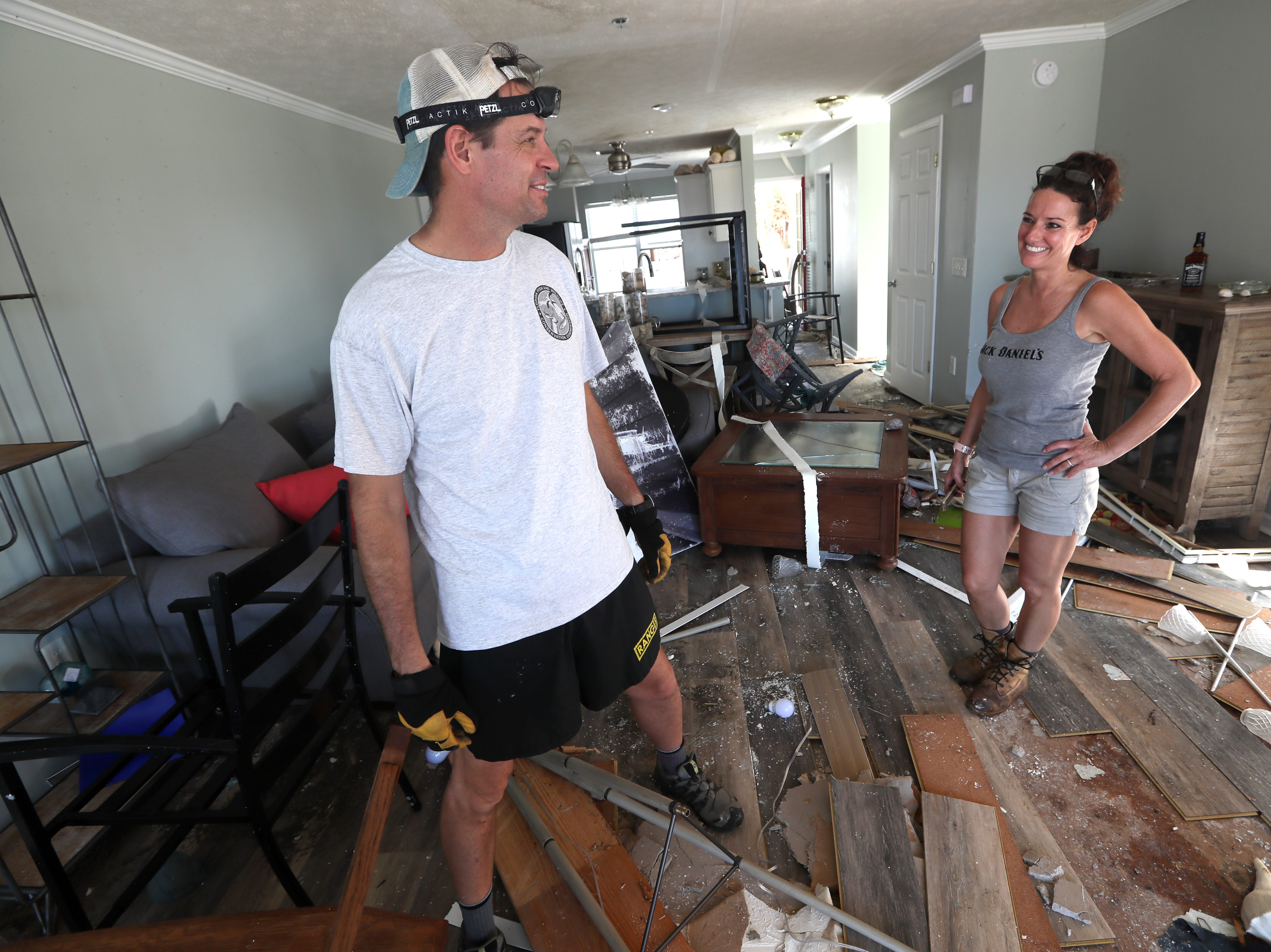 Brian Higdon shares a laugh with wife Kimberly during a lighter moment as they stand in their Mexico Beach condo on Wednesday, Oct. 17, 2018, one week after Hurricane Michael ripped through the coastal Florida town.