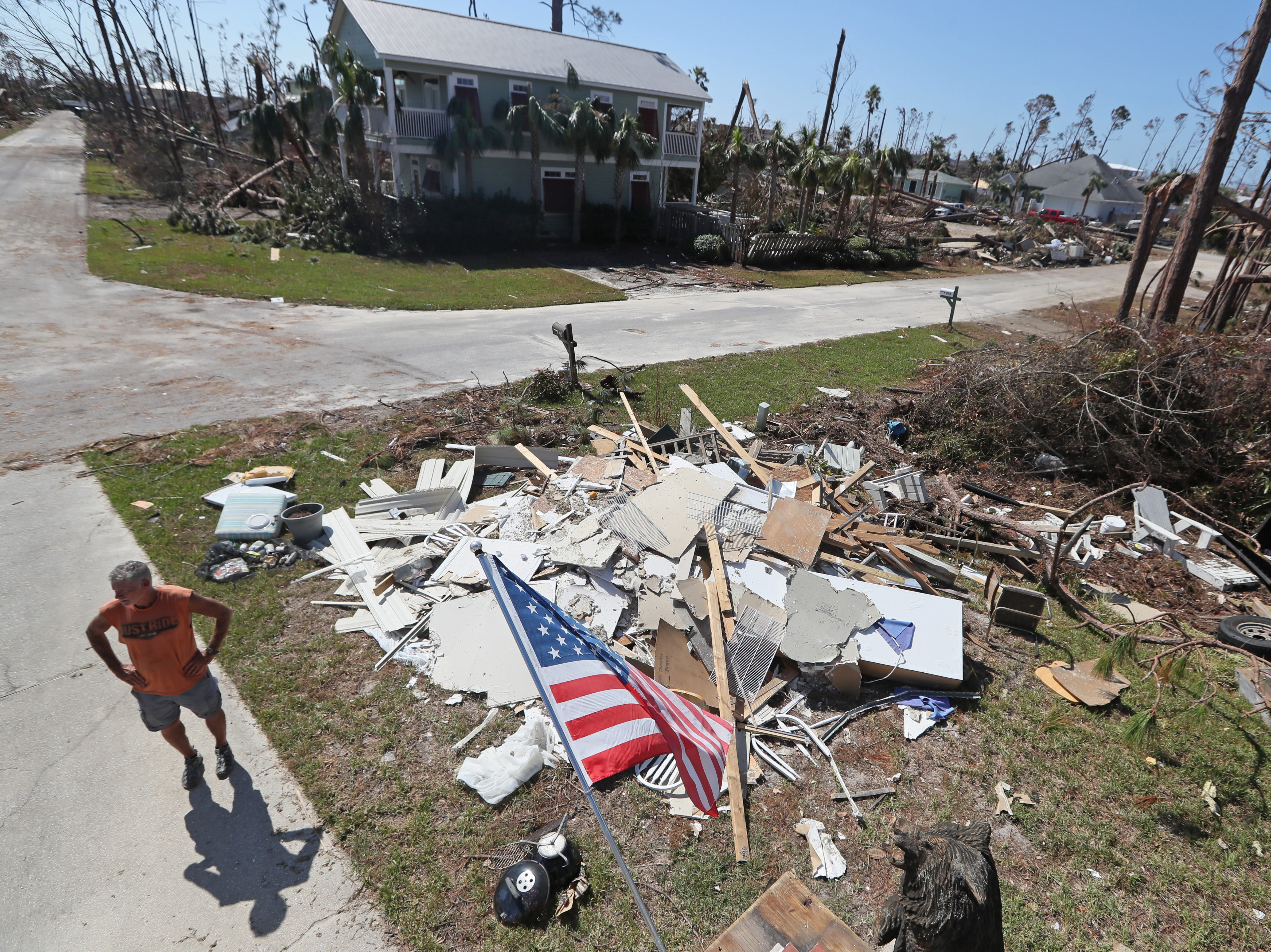 Mexico Beach resident Rick Barnes stands on his street next to his second-floor home, which was left destroyed on Wednesday, Oct. 17, 2018, one week after Hurricane Michael ripped through the coastal Florida town.