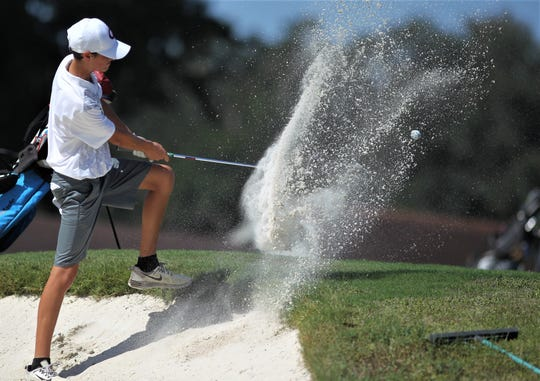 Chiles freshman Aiden Ash blasts out of a plugged lie in a bunker during the District 1-3A boys golf tournament at Hilaman Golf Course.