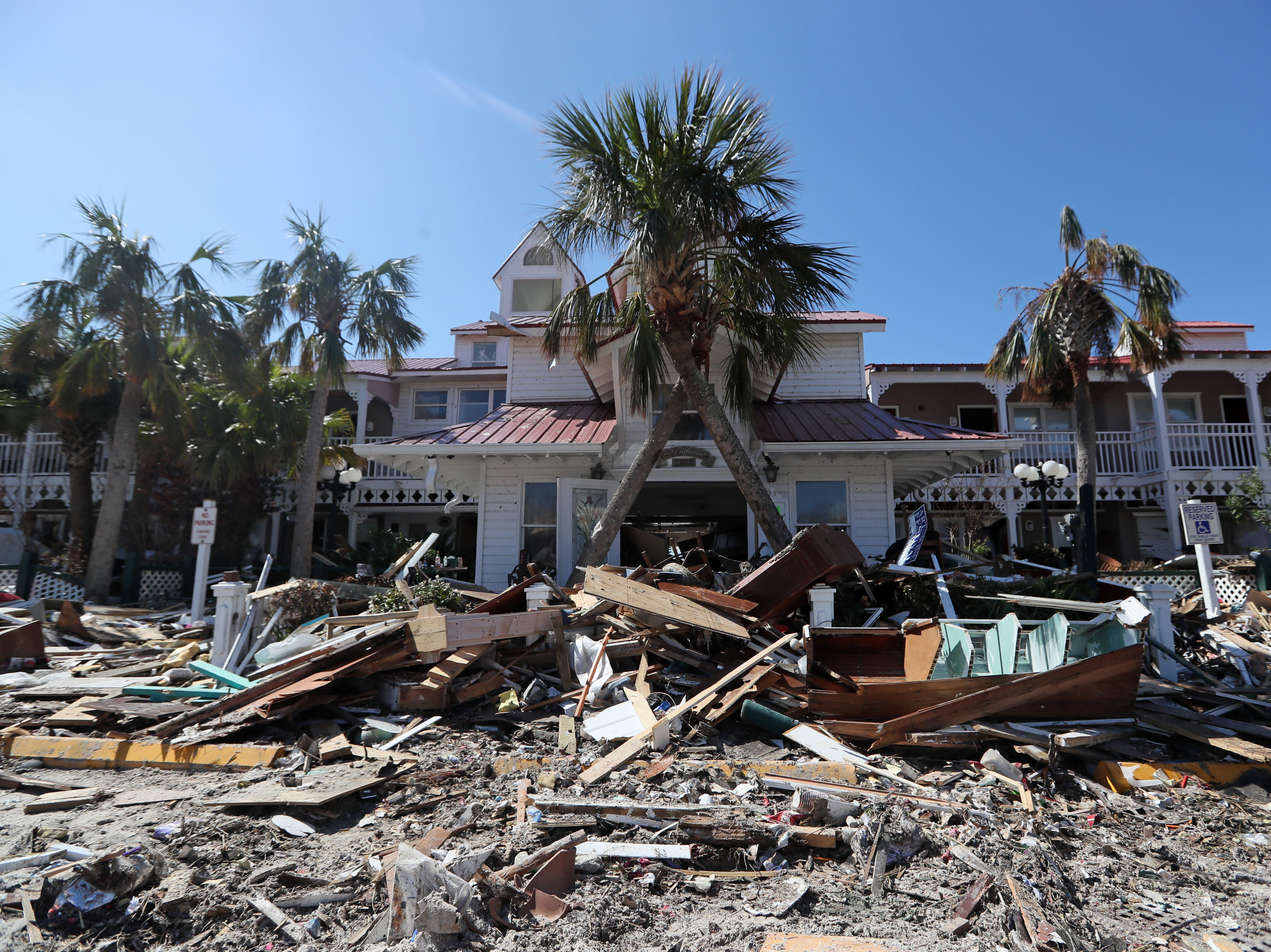 Scattered, broken homes litter the front of the Driftwood hotel in Mexico Beach on Wednesday, Oct. 17, 2018, one week after Hurricane Michael ripped through the coastal Florida town.