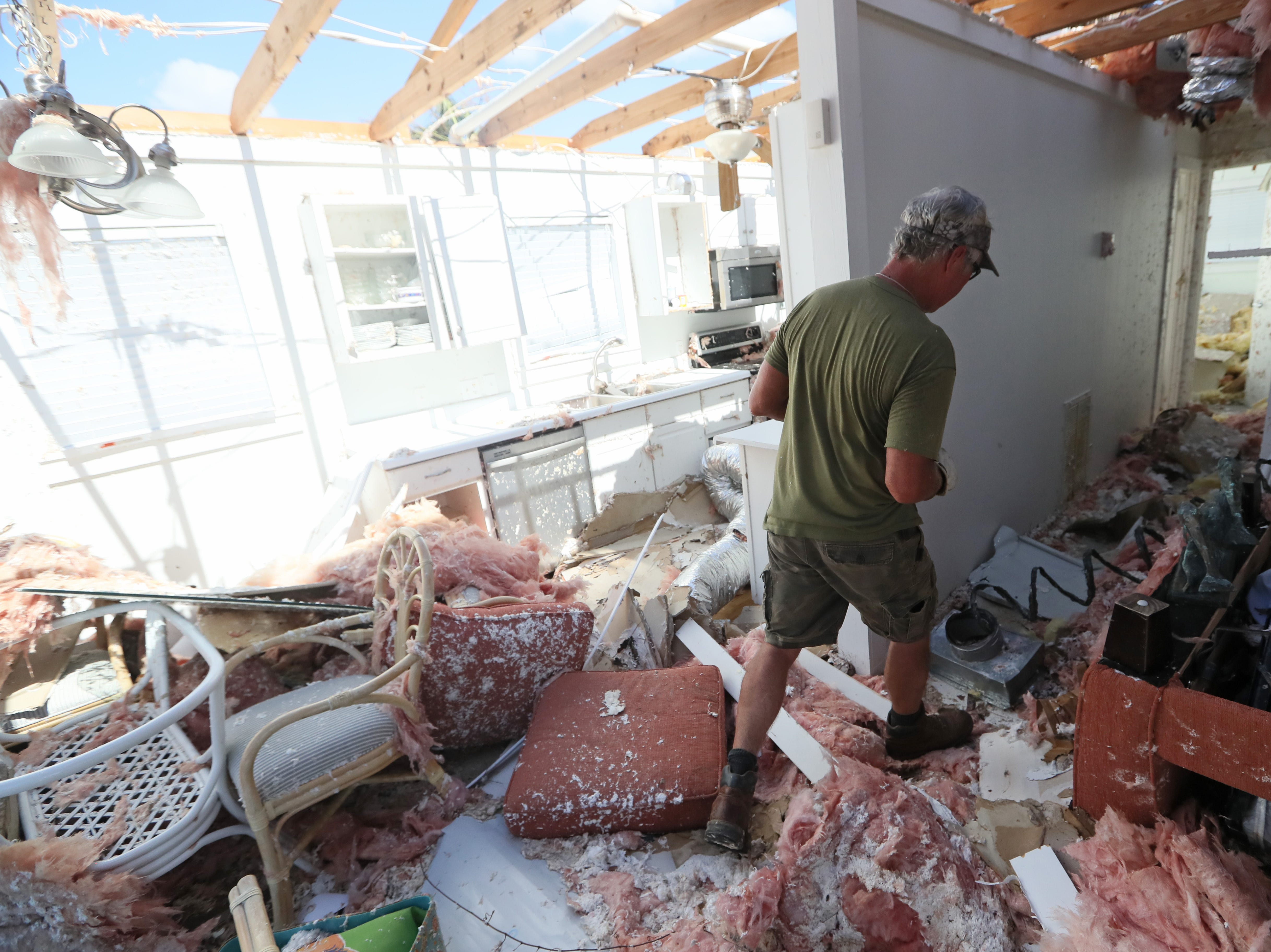 Mark Redd of Marietta, Ga. looks through his parent's vacation home in Mexico Beach on Wednesday, Oct. 17, 2018, one week after Hurricane Michael ripped through the coastal Florida town.
