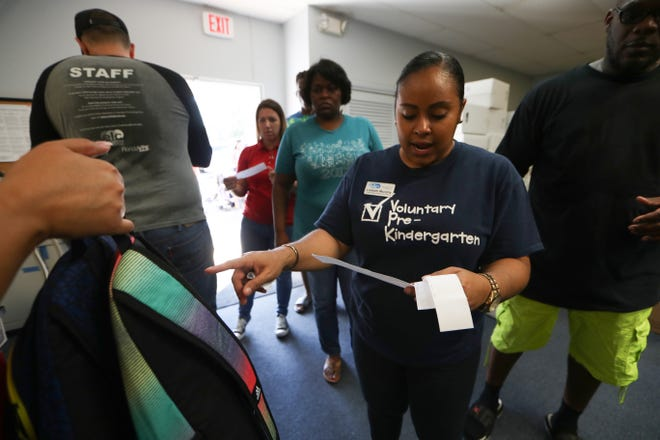 Lizbeth Murphy, who was named the new CEO of the Early Learning Coalition of the Big Bend Region in 2020, is shown here organizing supplies for families and children during an emergency response distribution at the ELC office in Quincy, Oct. 18, 2018. The distribution event was organized as a partnership between the ELC and Save the Children organization.