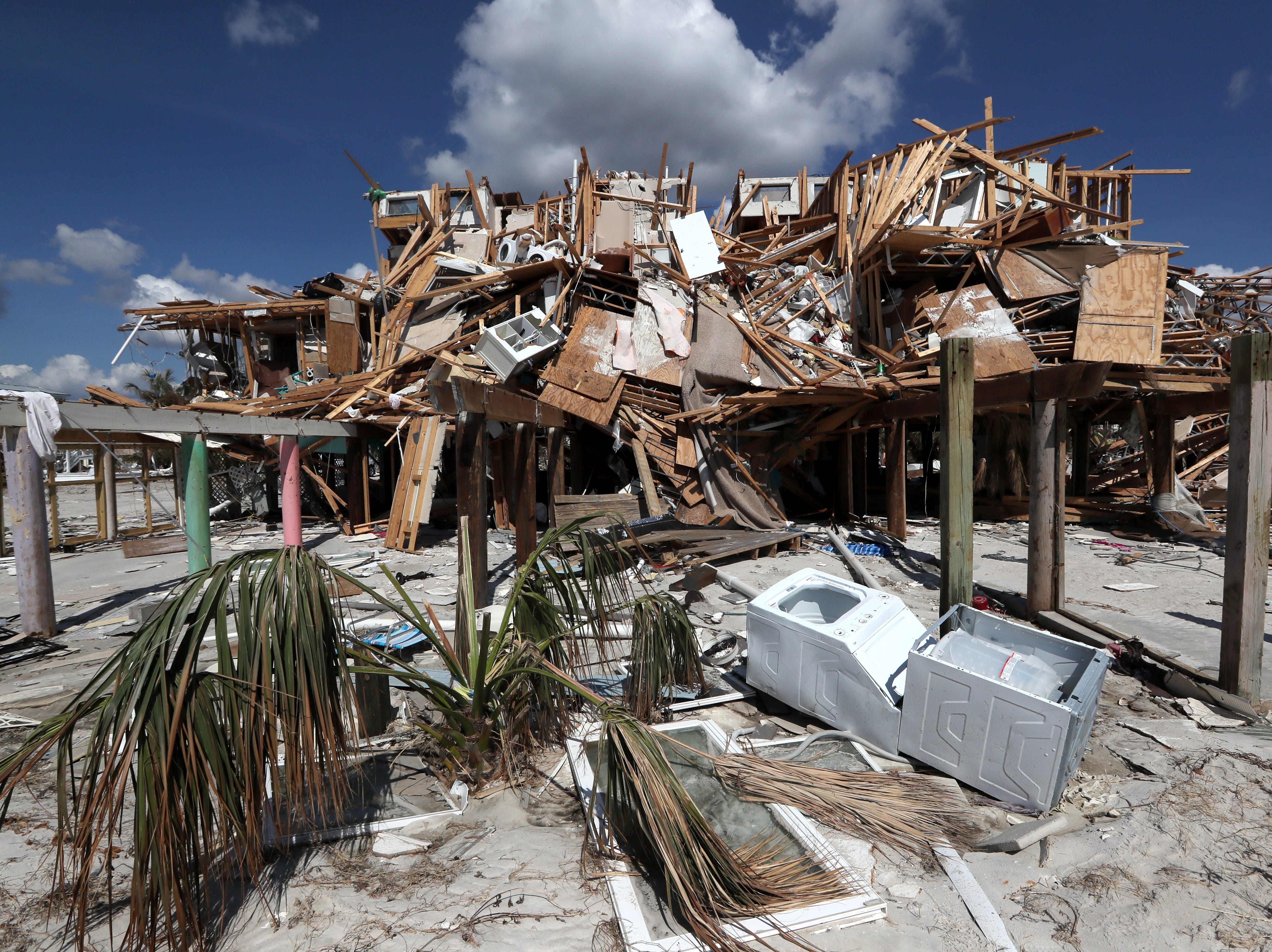 A mass of broken wood rest atop pilings on what was once home along the sand in Mexico Beach on Wednesday, Oct. 17, 2018, one week after Hurricane Michael ripped through the coastal Florida town.