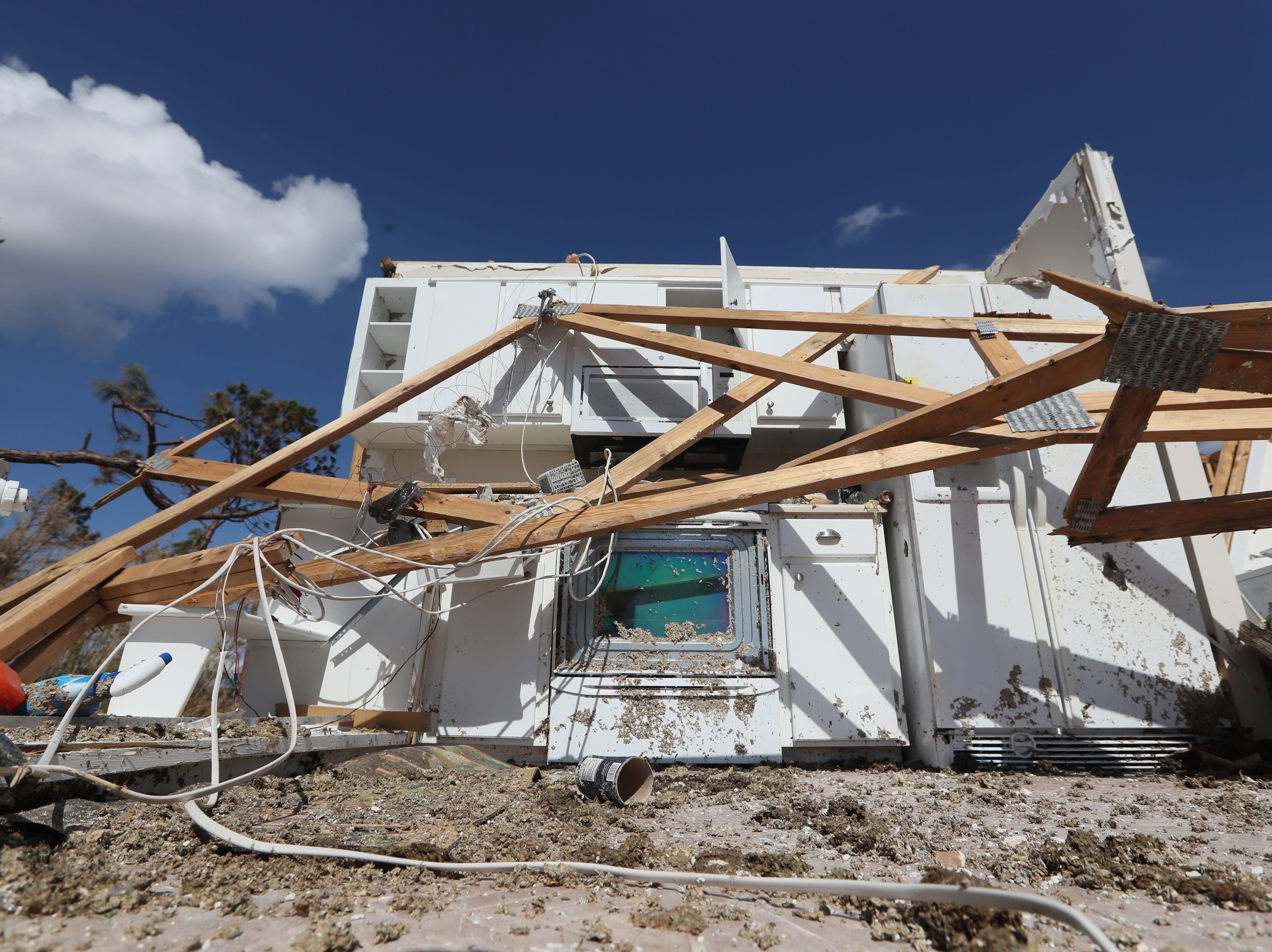 A row of kitchen appliances is the last standing wall on Rick Barnes second story home in Mexico Beach on Wednesday, Oct. 17, 2018, one week after Hurricane Michael ripped through the coastal Florida town.