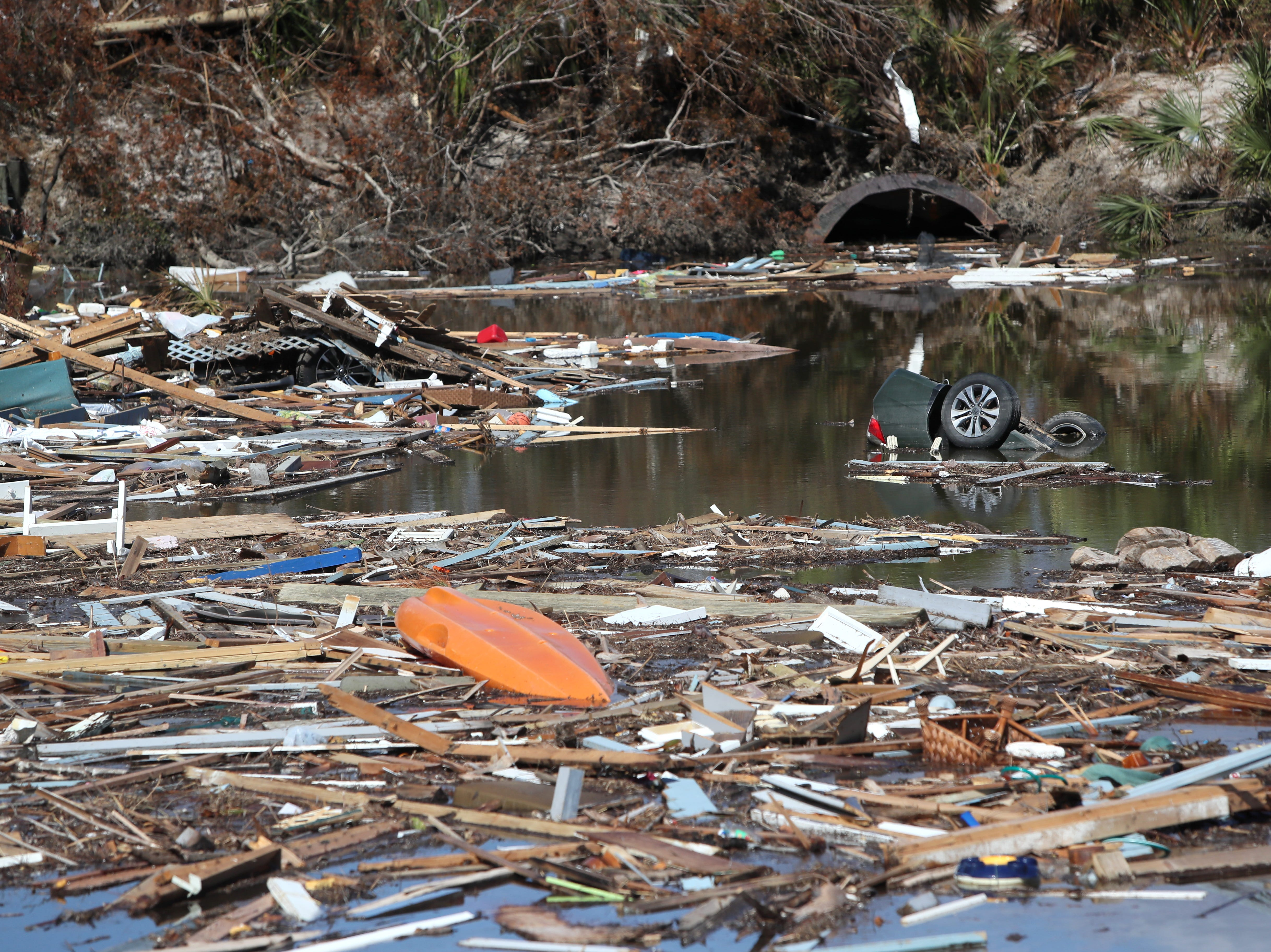 Scraps of homes and debris fill the waterways in Mexico Beach on Wednesday, Oct. 17, 2018, one week after Hurricane Michael ripped through the coastal Florida town.