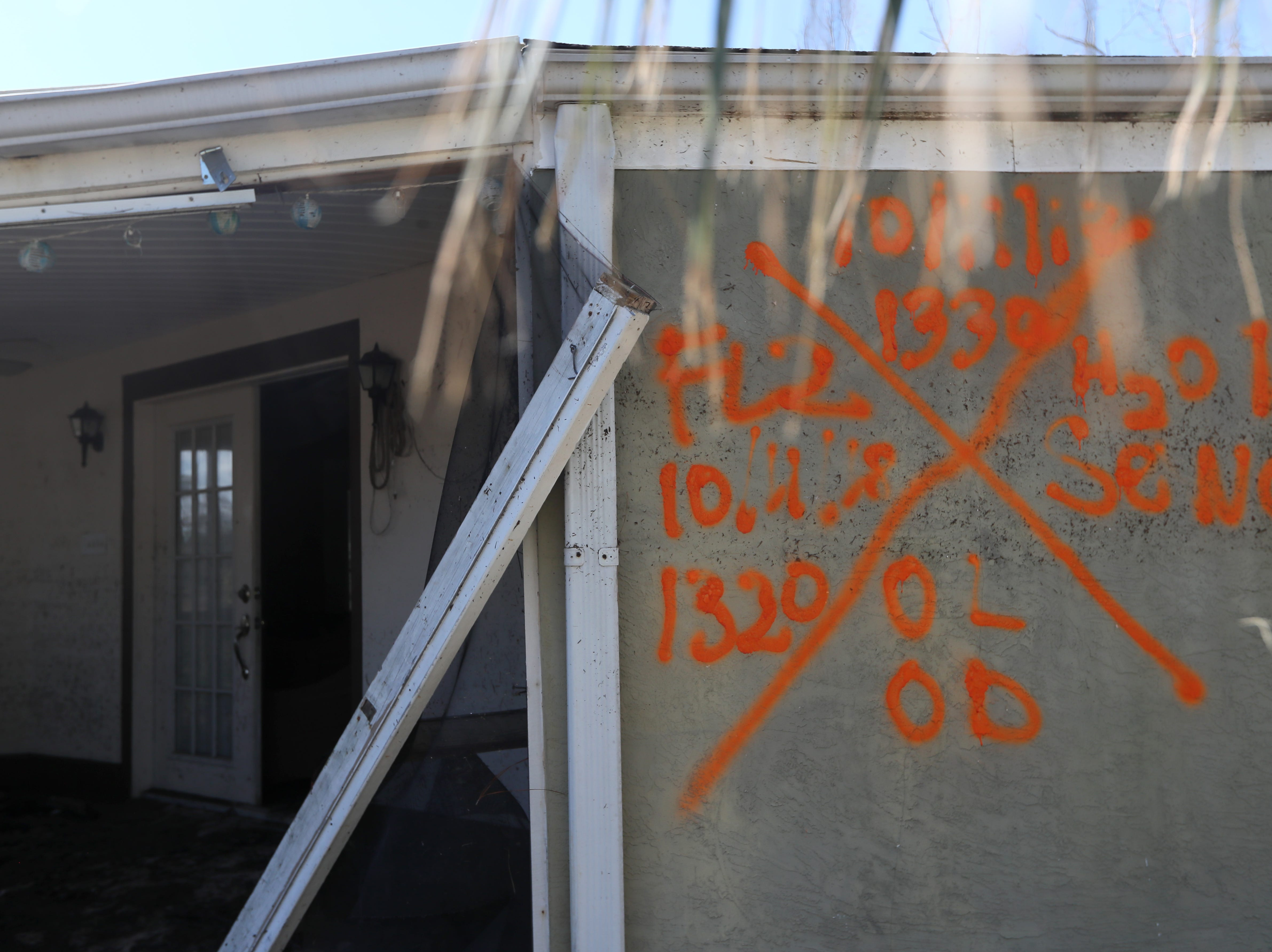 Spray painted details help to tell the story of first responder's search through dilapidated homes in Mexico Beach on Wednesday, Oct. 17, 2018, one week after Hurricane Michael ripped through the coastal Florida town.