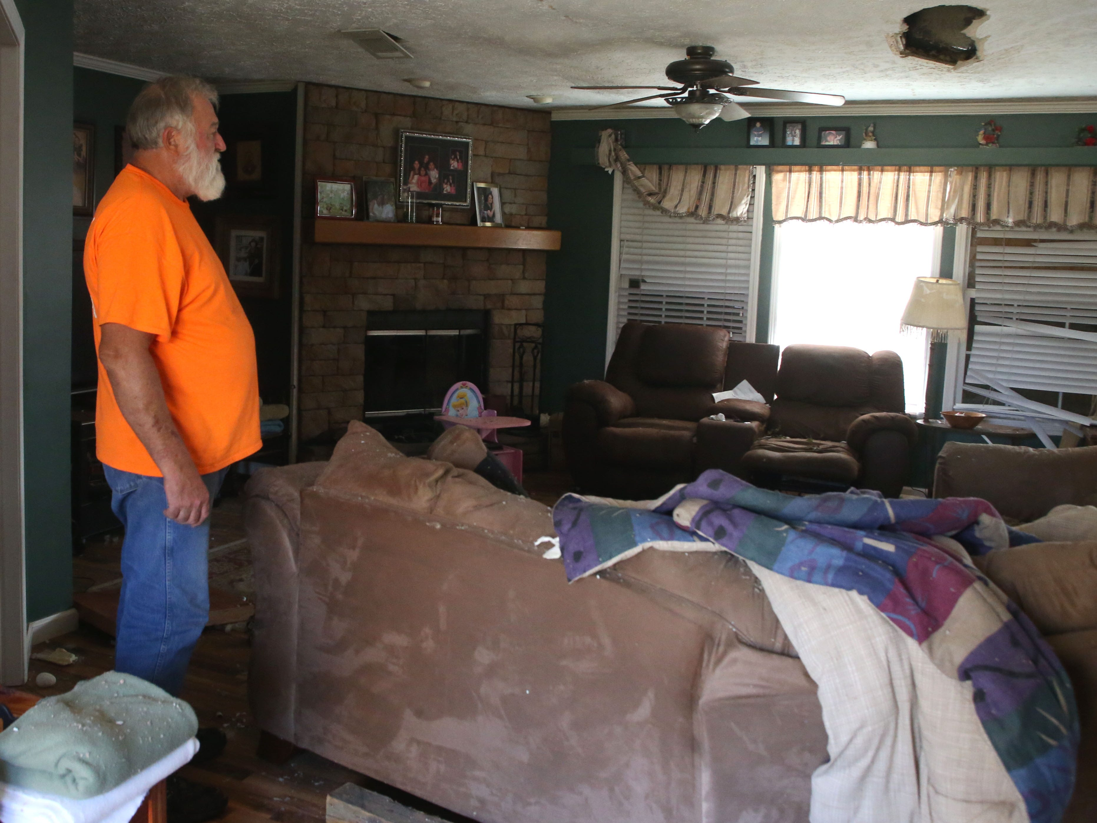 Eugene Radney, grandfather of Sarah Radney, an 11 year old girl who died during Hurricane Michael in Donalsonville, Ga., revisits his home where his granddaughter died on Thursday, Oct. 18, 2018.