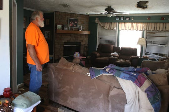 Eugene Radney, grandfather of Sarah Radney, revisits his home where his granddaughter died.