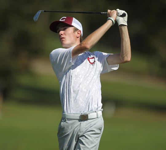Chiles sophomore Jake Springer watches a tee shot during the District 1-3A boys golf tournament at Hilaman Golf Course.