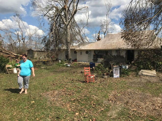 Ashey Evans and her 10-month-old son River are staying with her mom and stepfather in Clarksville after Michael heavily damaged their home in Altha.