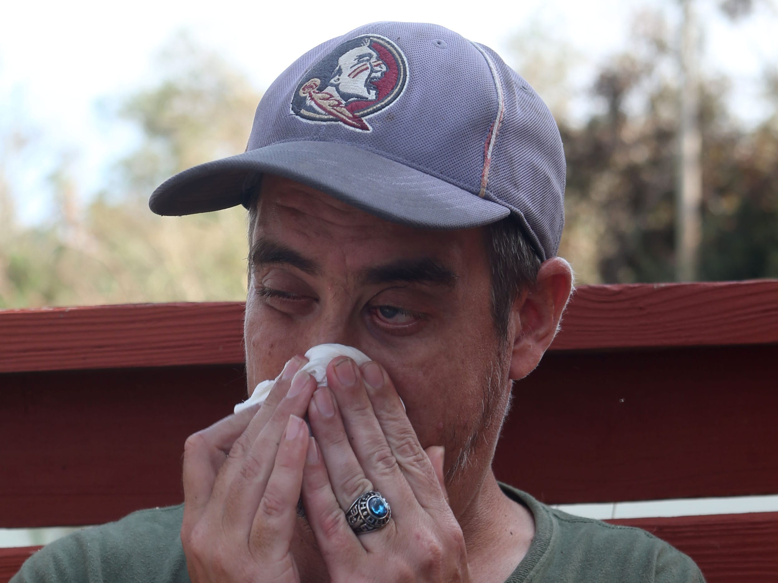 Ronnie Radney, uncle of Sarah Radney, an 11 year old girl who died during Hurricane Michael in Donalsonville, Ga., wipes away tears as his parents describe what happened during the storm on Thursday, Oct. 18, 2018.