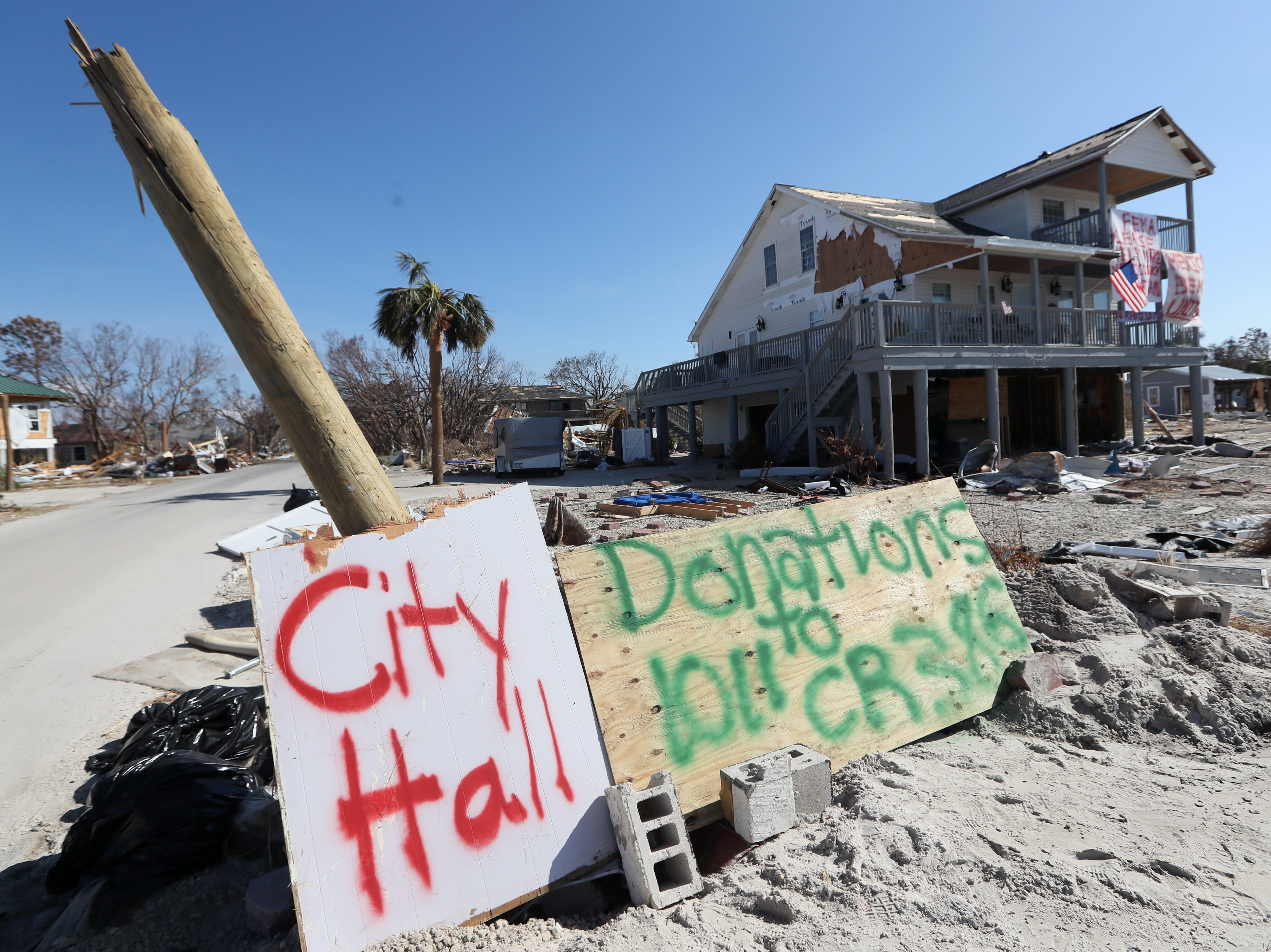 A makeshift city hall sign leads residents to an emergency station in Mexico Beach on Wednesday, Oct. 17, 2018, one week after Hurricane Michael ripped through the coastal Florida town.