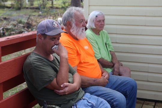 From left to right, Ronnie Radney, uncle, Eugene Radney, grandfather and Elizabeth Radney, grandmother of Sarah Radney, an 11 year old girl who died during Hurricane Michael in Donalsonville, Ga., as Eugene speaks about what took place during the hurricane on Thursday, Oct. 18, 2018.