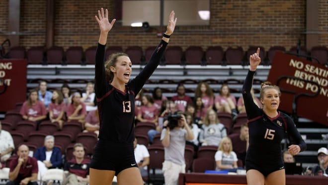 FSU's Paint it Pink match has special meaning for sophomore middle blocker Taryn Knuth (left).