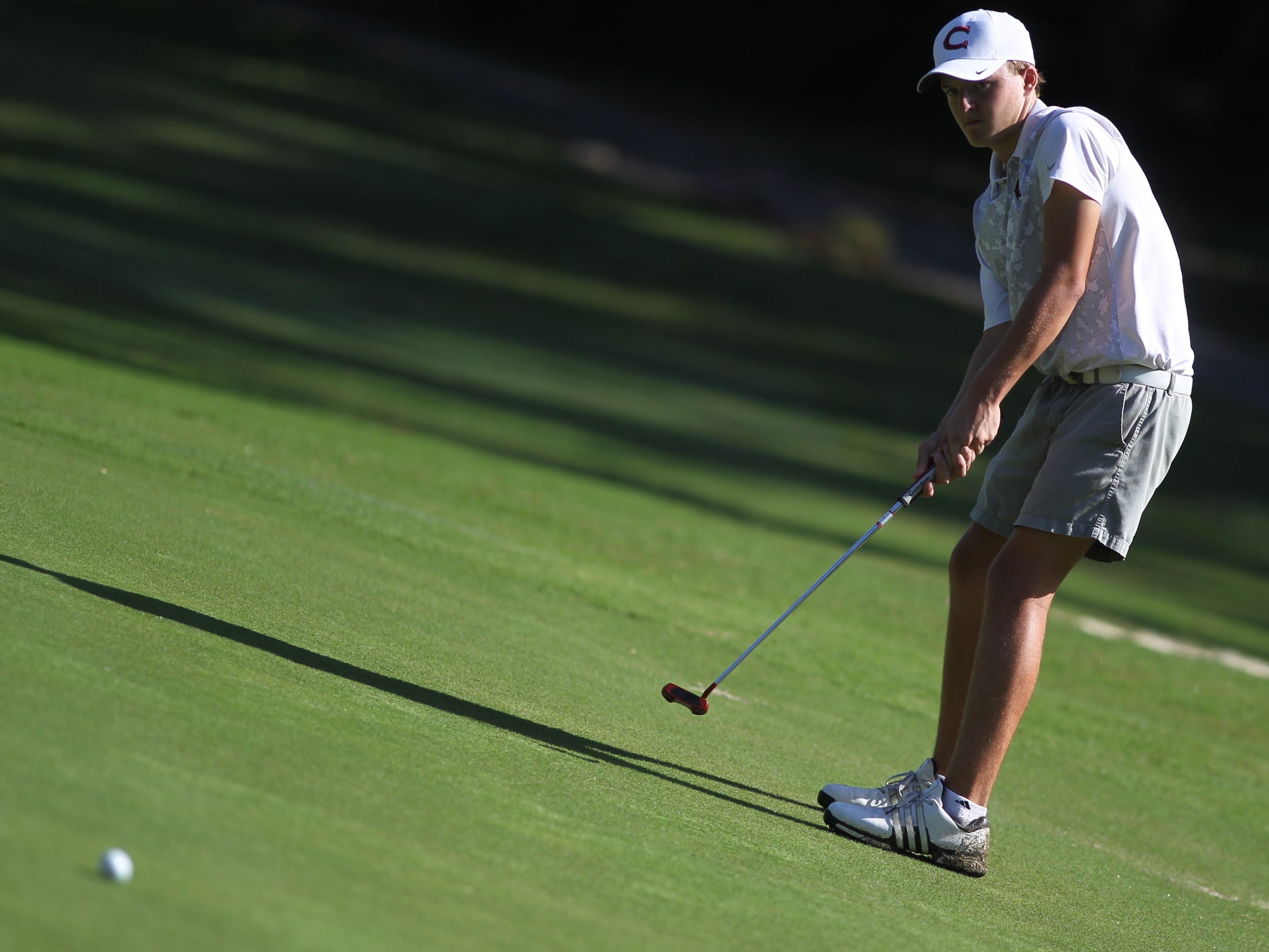 Chiles freshman Parker Bell putts during the District 1-3A boys golf tournament at Hilaman Golf Course. Bell won with a 2-under par 70.