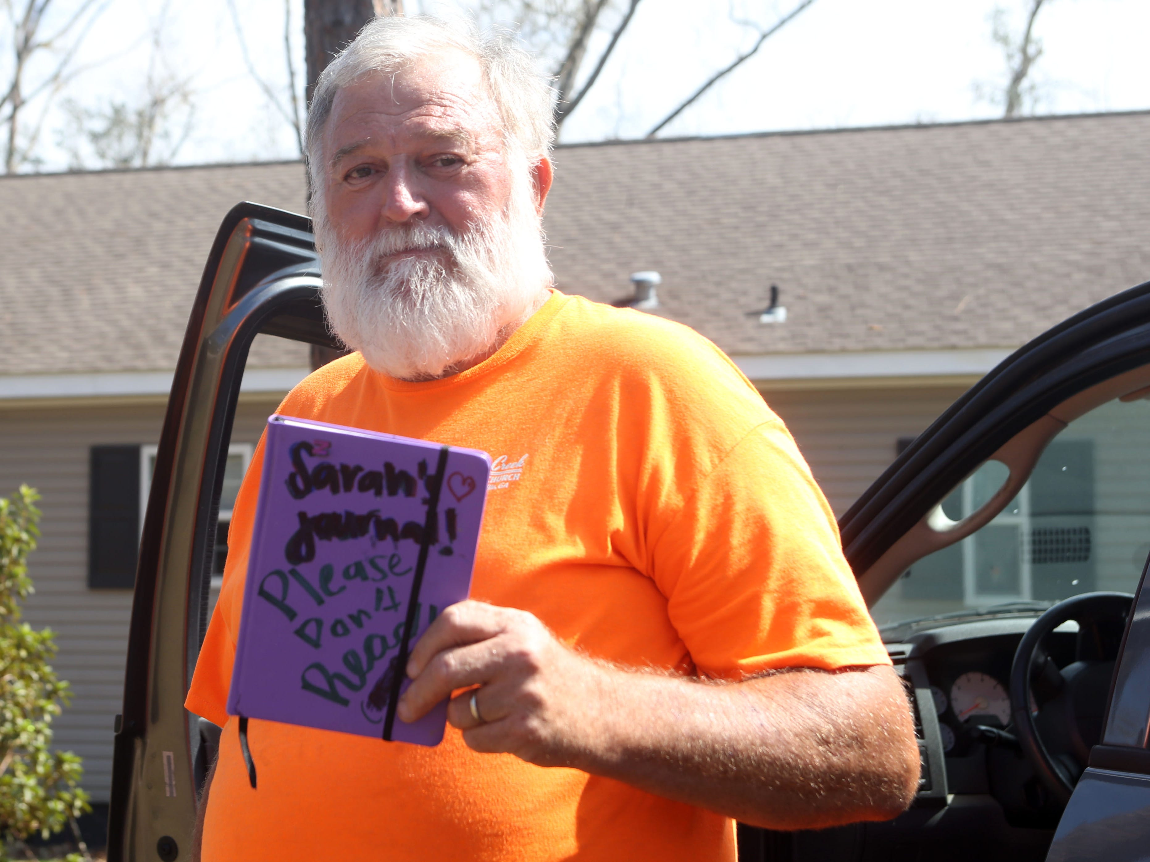 Eugene Radney, grandfather of Sarah Radney, an 11 year old girl who died during Hurricane Michael in Donalsonville, Ga., shows Sarah's journal on Thursday, Oct. 18, 2018.