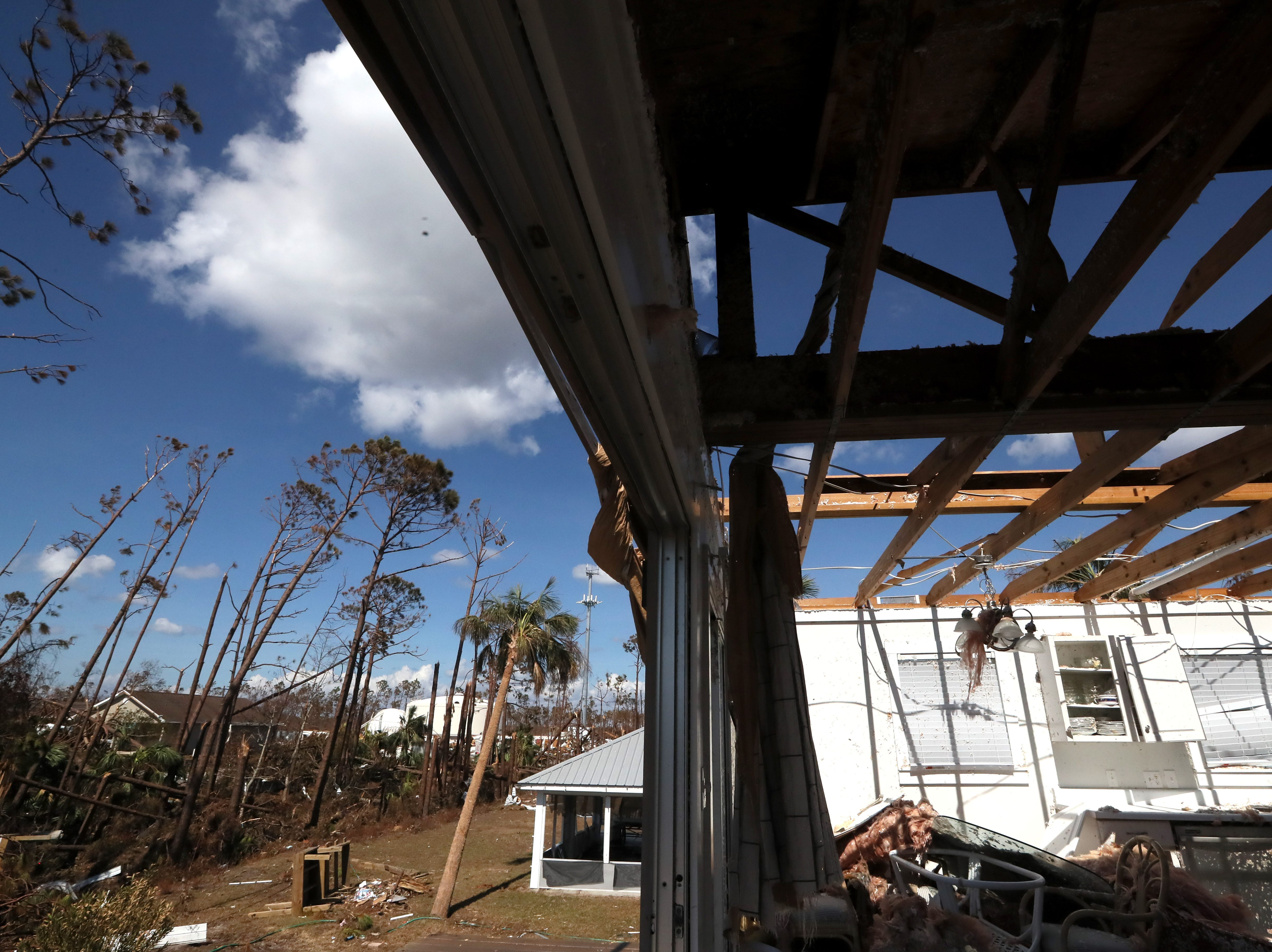 An open sky is seen through the roof of the Redd family vacation home in Mexico Beach on Wednesday, Oct. 17, 2018, one week after Hurricane Michael ripped through the coastal Florida town.