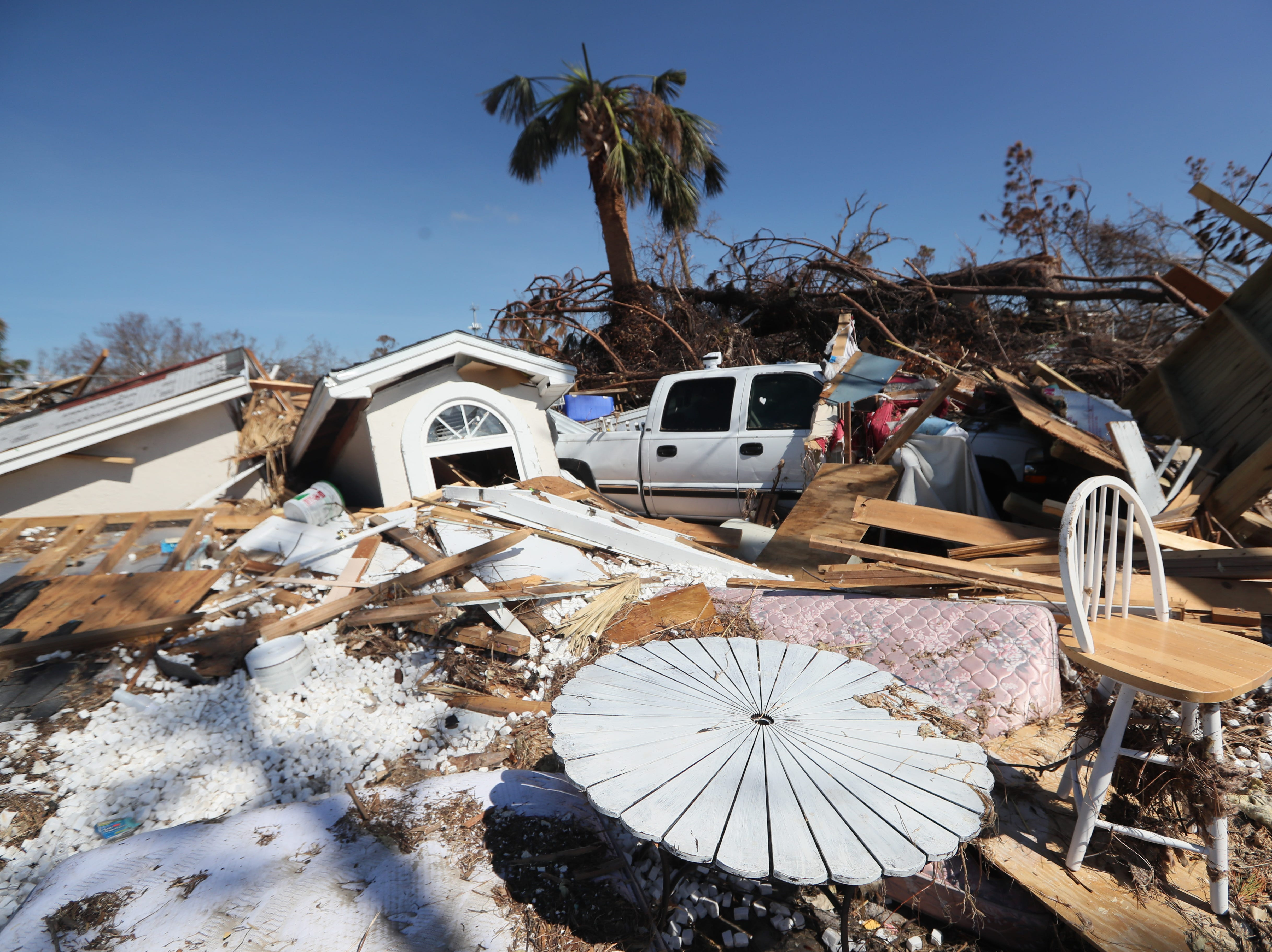 Houses are left demolished in Mexico Beach on Wednesday, Oct. 17, 2018, one week after Hurricane Michael ripped through the coastal Florida town.